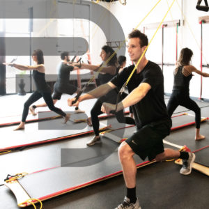 Group wearing black using the BOARD30 system during a HIIT workout at BOARD30 arvada