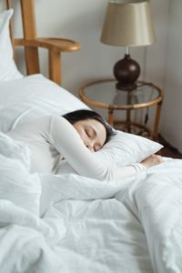 woman sleeps to recover from workout